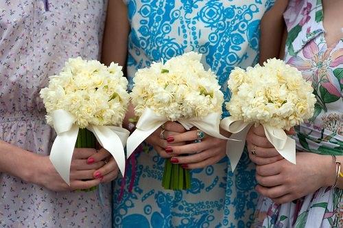 Bridesmaids wearing matching dresses
