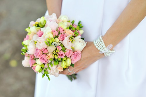 Carrying a bridal bouquet