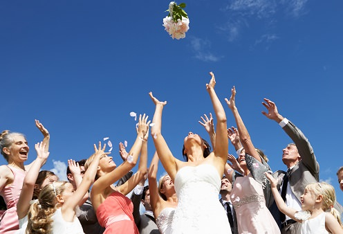 Tossing the bridal bouquet