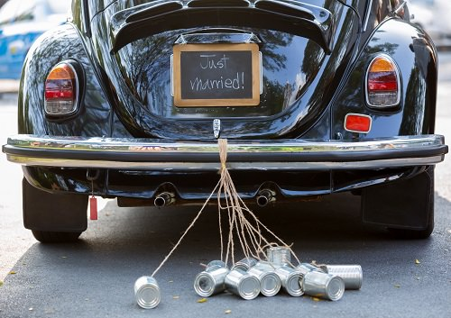 Tying tin cans to the newlywed couple's car